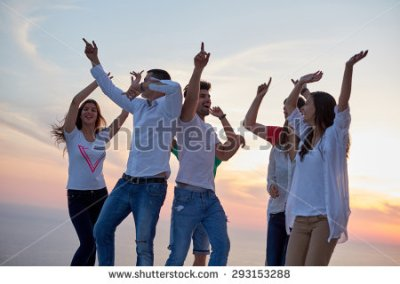stock-photo-group-of-happy-young-people-dancing-and-have-fun-on-party-in-modern-home-bacony-with-sunset-and-293153288